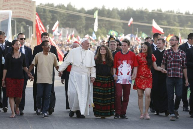 Pope Francis walks with World Youth Day pilgrims as he arrives for a July 30 prayer vigil at the Field of Mercy in Krakow, Poland. (CNS photo/Paul Haring) See POPE-POLAND-WYD-VIGIL July 30, 2016.